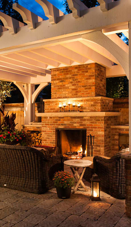 Outdoor fireplaces in the back yard provide heat in the cool Calgary evenings.