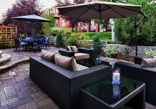 Stamped concrete patios designed in Calgary back yard.